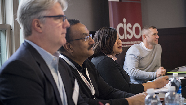 Students in the CISO class listen to an instructor