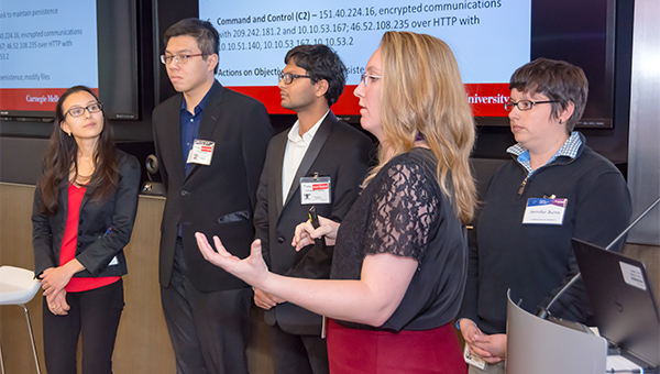 Five students presenting at a conference