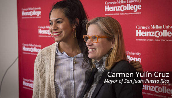 Carmen Yulin Cruz posing with a student
