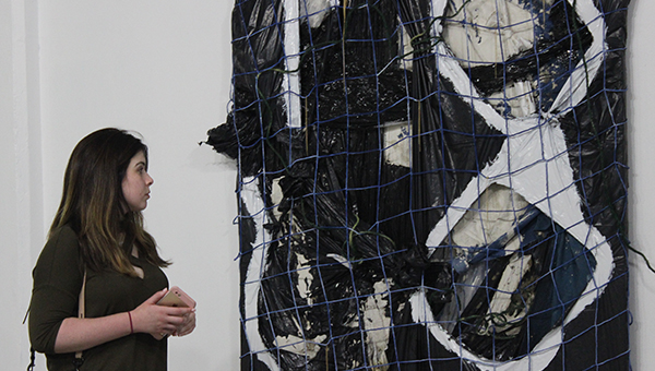 A Student Examines an art installation at Future Tenant Art Space