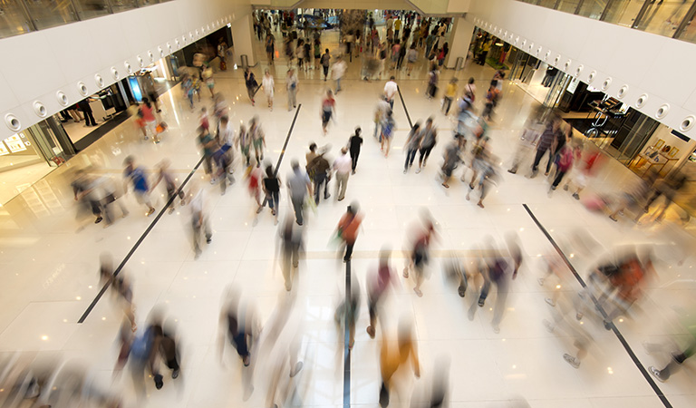 image of consumers in a mall with blurred motion