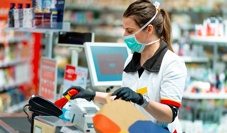 image of a retail worker wearing a facemask and gloves